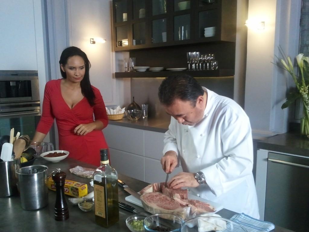 Bridget Davis and Tetsuya Wakuda cutting a slab of wagyu