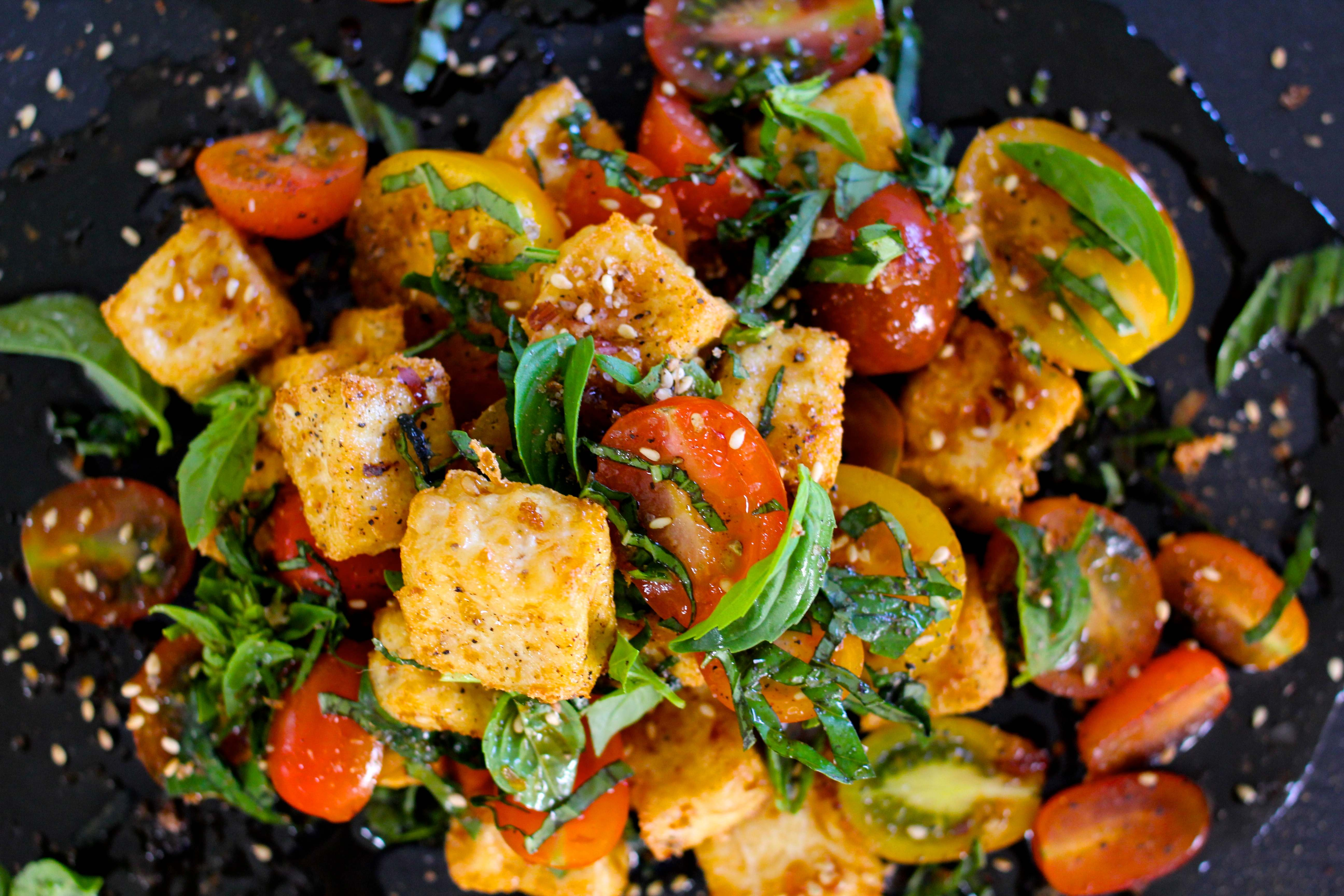 Mirin and Soy dressed tofu croutons with heirloom tomatoes and basil